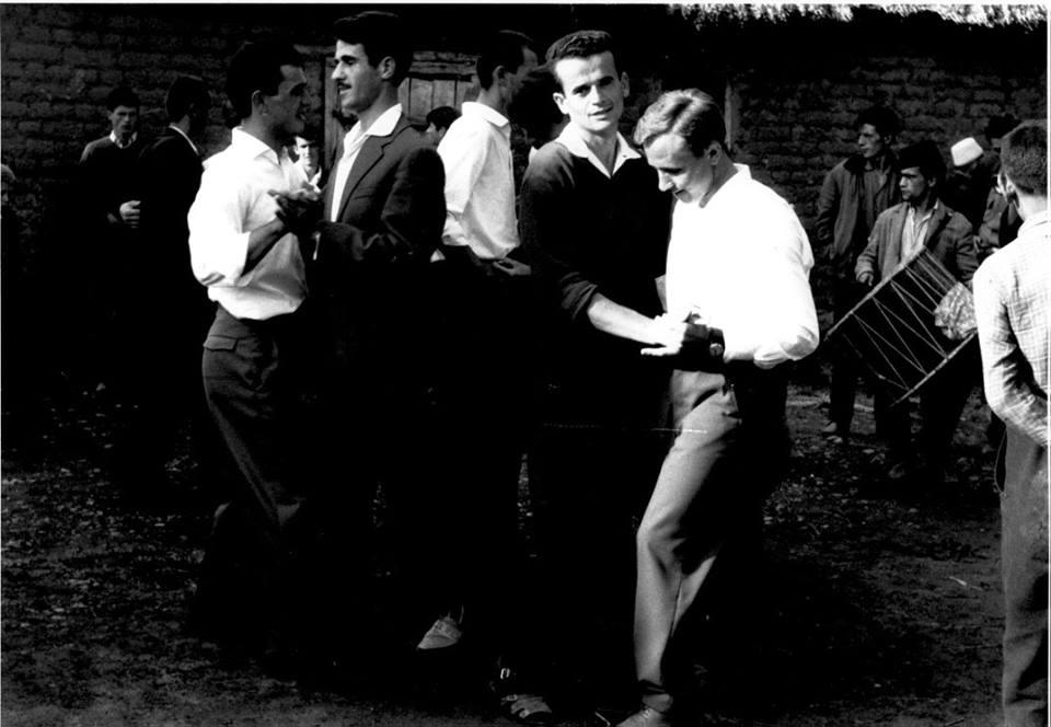 Albanian men dancing together